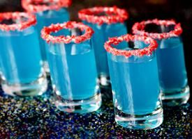 Blue Kamikaze Shot  Blue curacao, lime juice, vodka, and pop rocks for the rim of the shot glass