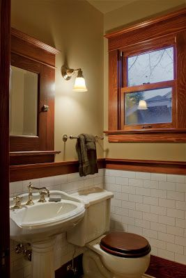 saves a lot of money to use wood trim around wainscot instead of tile trim, which is at least $30 per foot.