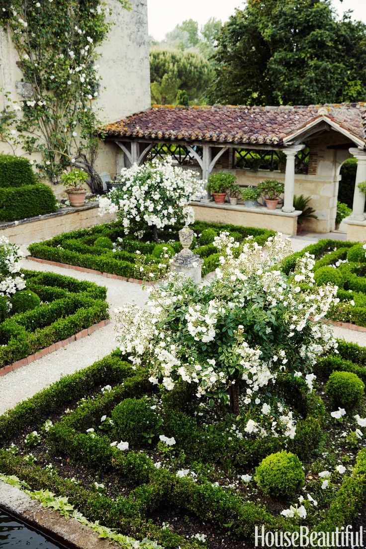 """The Cloister Garden in William Christie's 16th-century house in France features the classic rose Katharina Zeimet. """"The garden is very personal and breaks all the rules,"""" Christie says. """"But I am immensely happy and proud of it. I spend as much time as I can here. I don't need to take vacations anywhere else."""" Simon Watson  - HouseBeautiful.com"""