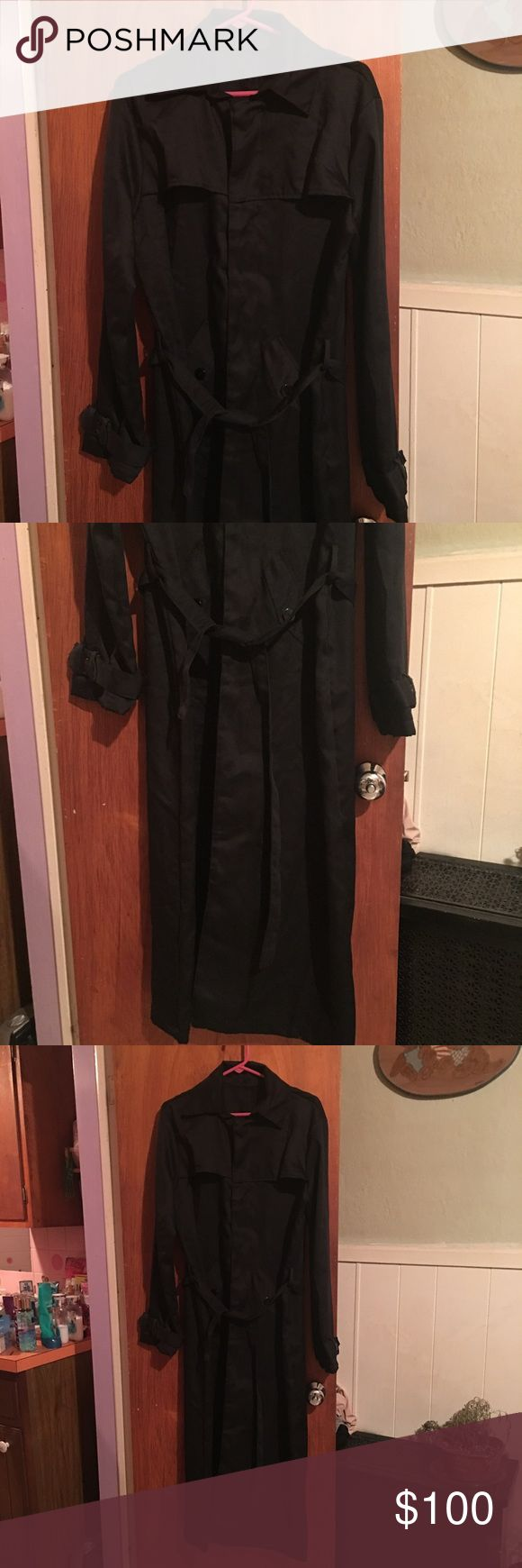 NWOT Black full length trench coat sz M/L Never worn, ive had this for a few years & it's been hanging in my closet. I love it but time to make room for stuff I actually wear lol.. Black full length trench coat, no size tag plz refer to to measurements, it's either a M or L.  Brand is unknown. I got this online I can't even remember the name of the website. It was a gothic/punk store. This is lightweight, it has snaps down the front, and relies in front. Pit-pit 21 inches, pit to bottom 40…