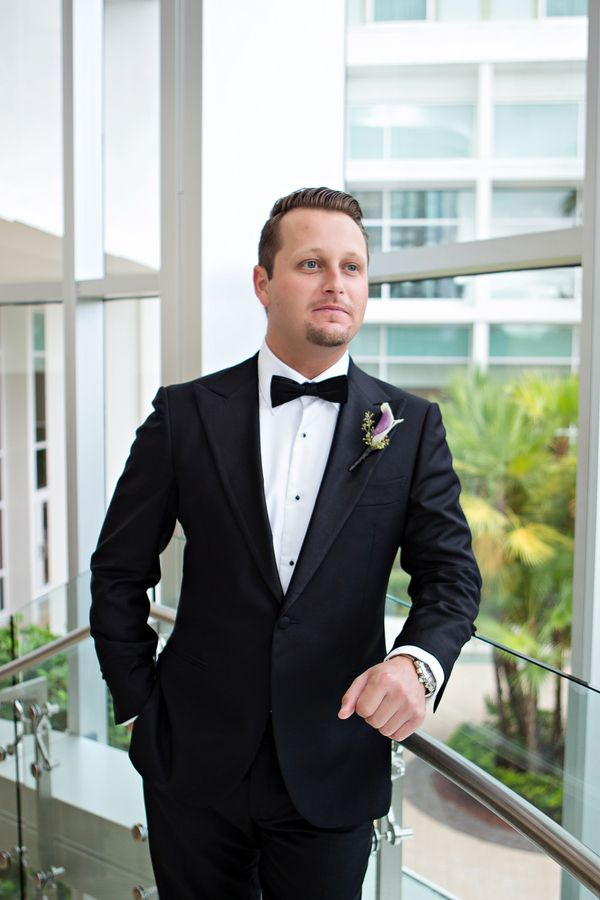 Dapper groom with calla lily boutonniere (Photo by Kristen Weaver Photography)