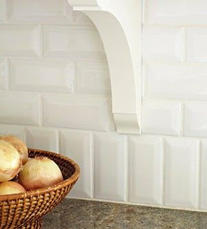 "Instead of having a granite 4"" back splash, just turn your subway tile vertical! A fun and interesting detail."