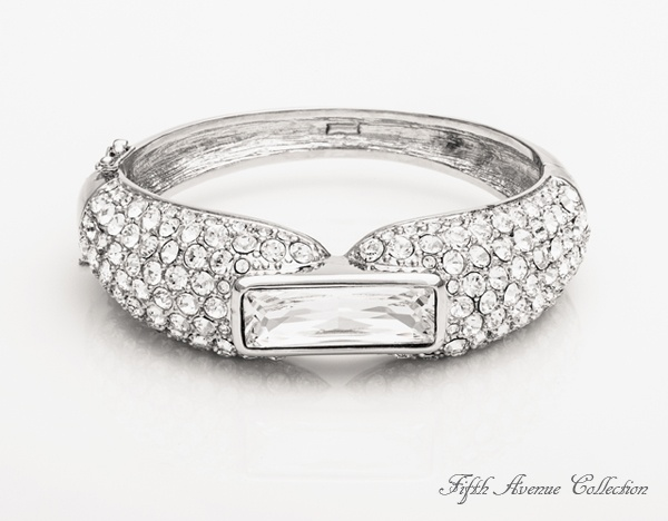 A large Swarovski baguette crystal accompanied by over a hundred sparkling rounds is sure to be noticed each time you clasp on this gorgeous cuff bracelet.  Fifth Avenue Collection's fine fashion jewellery… designed to be cherished. #jewellery #bracelet #statement #swarovski #fashion