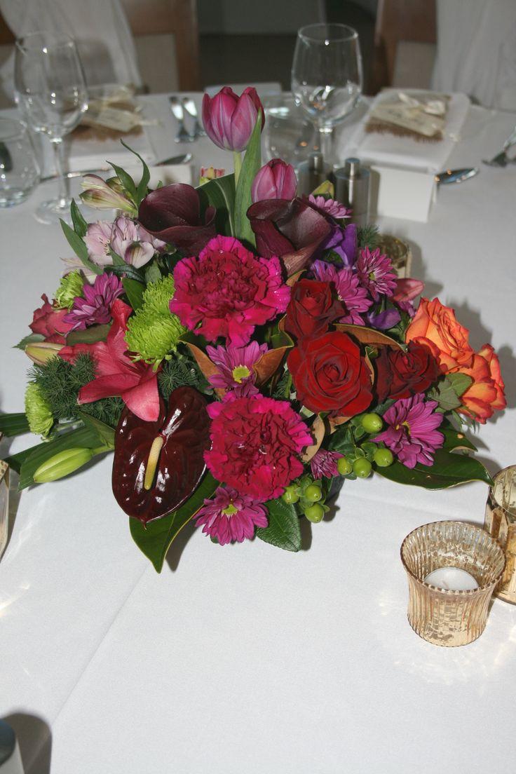 Unique, custom designed wedding flowers - Table arrangements