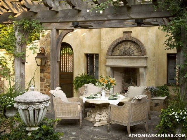 A wooden pergola and built-in fireplace match perfectly with the home's architecture and color scheme. Description from pinterest.com. I searched for this on bing.com/images