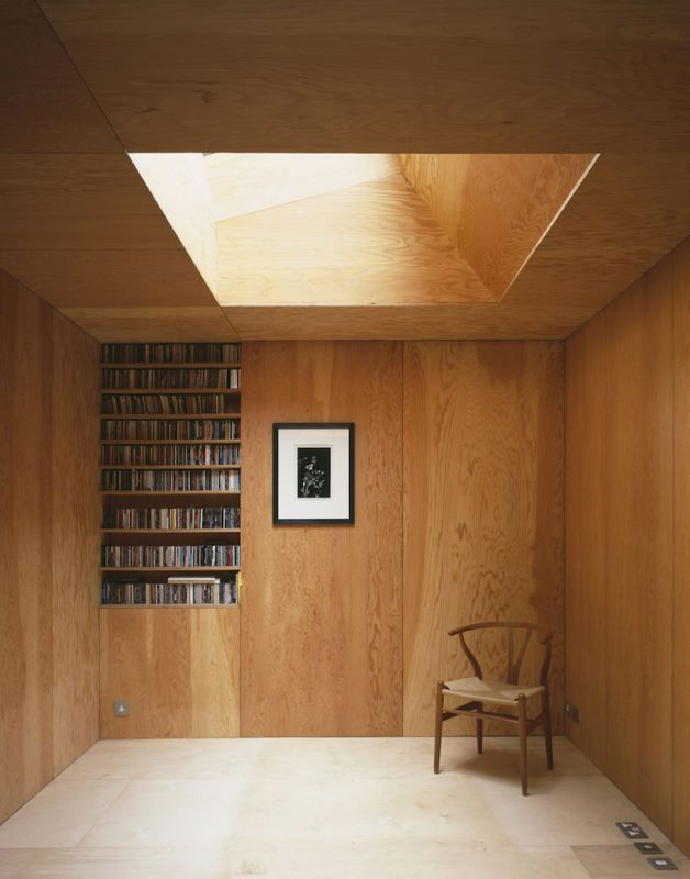 Private house - timber interior brings warmth, lit from above an integrated rooflight