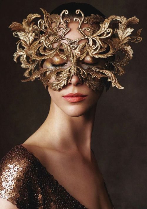 One of my favorite images of masks....very artisticly elegant!