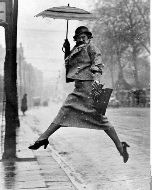"Martin Munkácsi: ""The Puddle Jumper,"" 1934.Sports Photography, Martin Munkacsi, 1934, Umbrellas, Martinmunkácsi, Online Job, Puddle Jumpers, Rain, Martin Munkácsi"