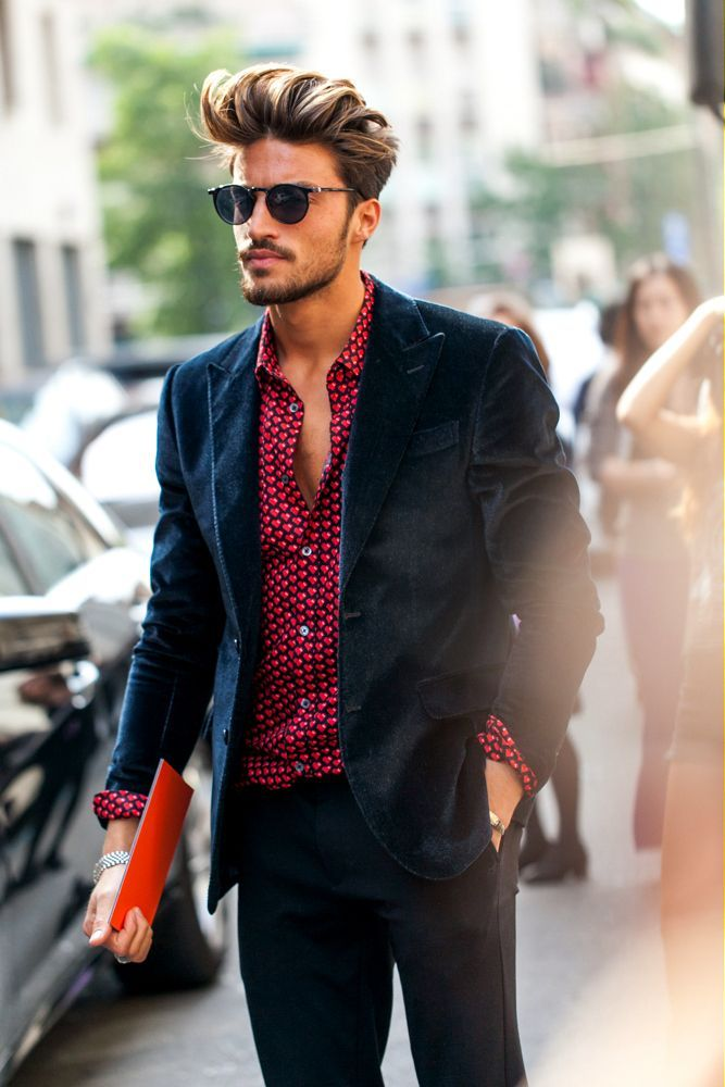 Shop this look on Lookastic:  https://lookastic.com/men/looks/navy-velvet-blazer-red-print-dress-shirt-charcoal-dress-pants/1111  — Navy Velvet Blazer  — Red Print Dress Shirt  — Charcoal Dress Pants