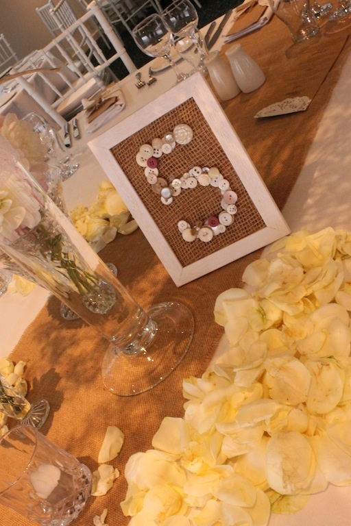 table numbers made by Jenna out of #buttons