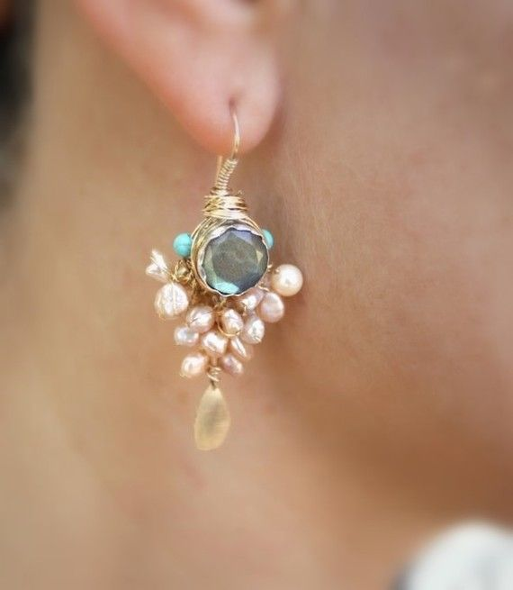 I like these the best! I would wear these every chance that I'd get!  Gorgeous design, love the turquoise pop and best of all(besides the gorgeous stone) is the dangling light catcher at the bottom..simply beautiful!