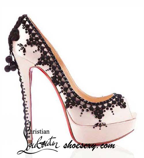 Pink satin and black lace shoes by Christian Louboutin.