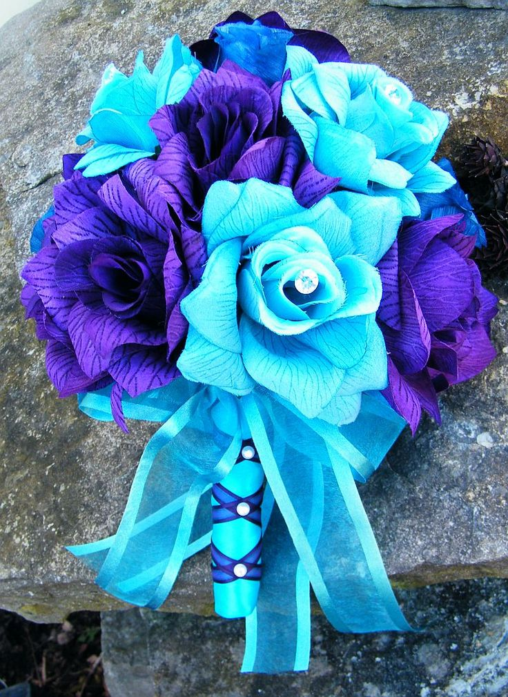 "This 11"" round bouquet was created with deep purple and turquoise roses.. I added faux diamonds as well..The price for this bouquet is $60.00"