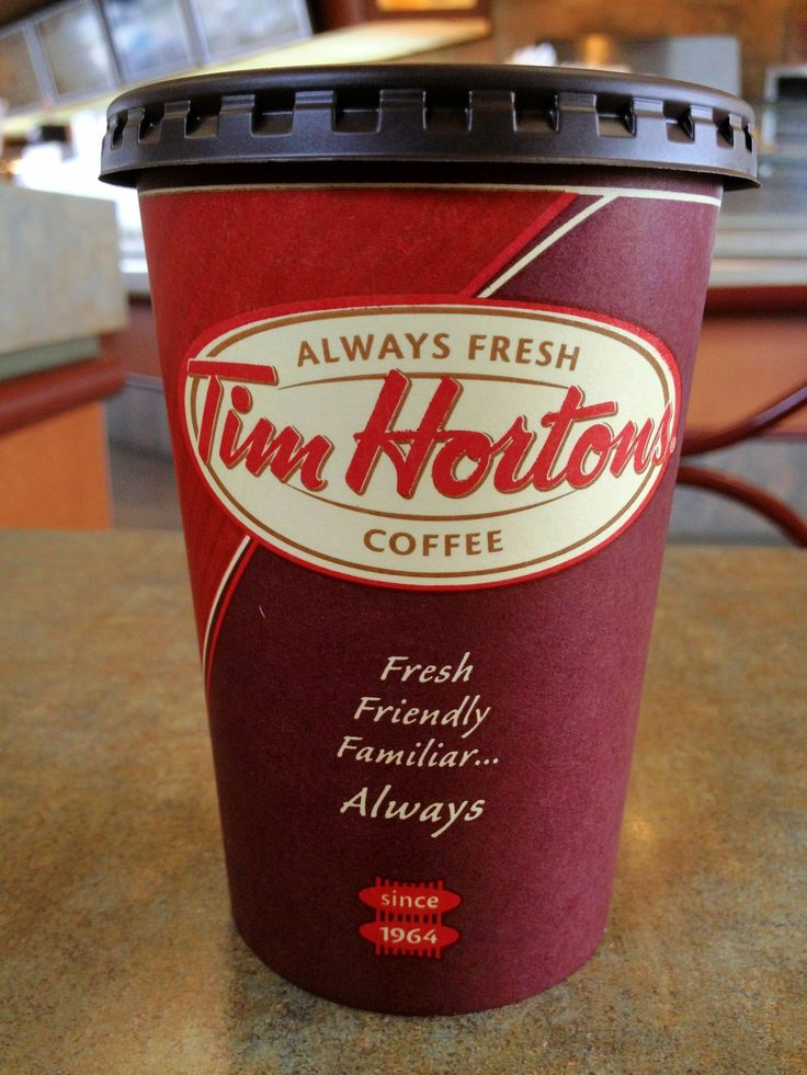 Tim Hortons coffee - carry a cup down the isle to him