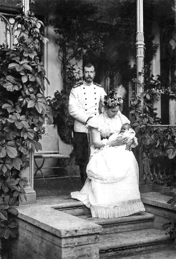 Emperor Nicholas II and his consort Alexandra Fyodorovna and their second child Grand Duchess Tatiana Nikolaevna, for whom this 1897 formal photo session was to be the first of many more to come.