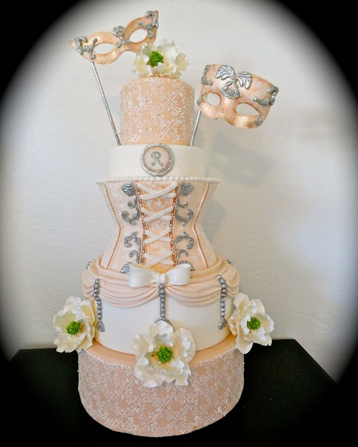 Masquerade Wedding Cake...my vision come to life...a year and a half after our wedding...but being able to make this dream cake a reality was the greatest experience!