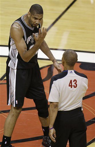 San Antonio Spurs  forward Tim Duncan (21) talks to NBA official Dan Craford (43) during the first half in Game 7 of the NBA basketball championships against the Miami Heat, Thursday, June 20, 2013, in Miami
