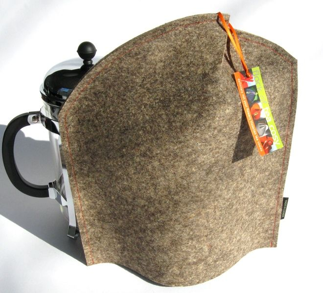 Modern tableware: Neu Coffee Cozy in Industrial Felt.  Clever opening for the french press plunger. This is the natural baa-baa sheep's wool colour mixed together. #modern #coffeecozy #bodum #coffeecosy #industrial #woolfelt #architect #gift #coffee #drinker