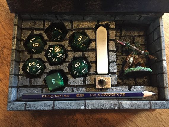 Custom made Dice Box for your tabletop adventures. Sturdy cardboard box with magnetic lid. Comes with pencil, metal sharpener and eraser.