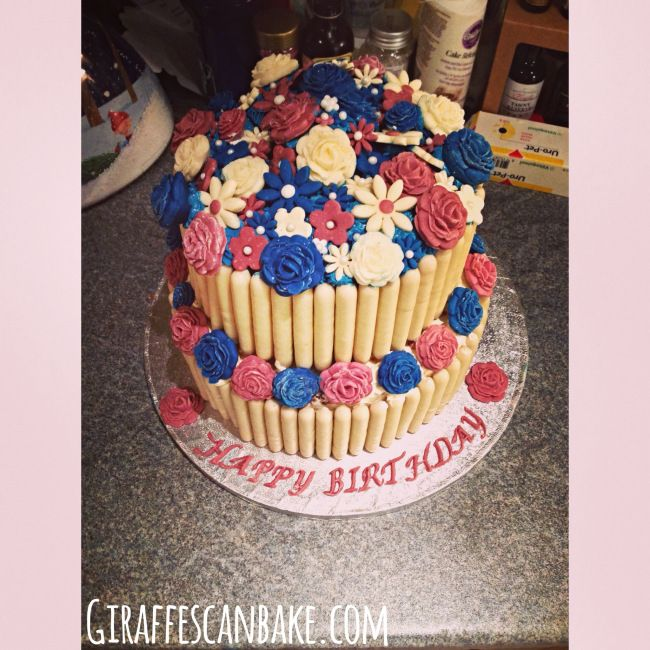 Cake Decorated With Chocolate Fingers And Counters