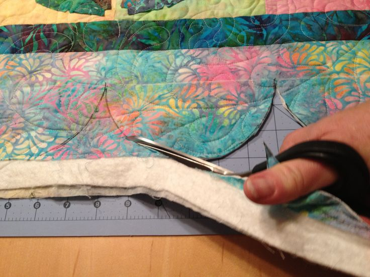 A scalloped border--whether shallow or deep--instantly adds graphic interest to a quilt, and it's not as hard as it looks. (For scallops in action, take a look at Baby Bubblicious by Victoria Findl...