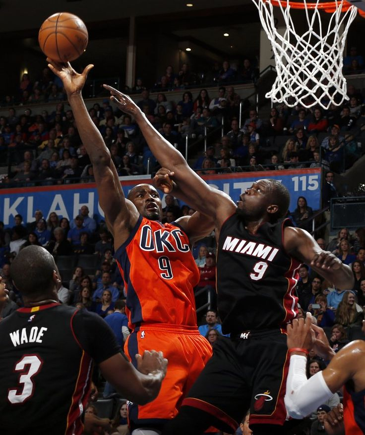 Oklahoma City's Serge Ibaka (9) tries to grab a rebound against Miami's Luol Deng (9) during an NBA basketball game between the Oklahoma City Thunder and the Miami Heat at Chesapeake Energy Arena in Oklahoma City, Sunday, Jan. 17, 2016. Photo by Nate Billings, The Oklahoman