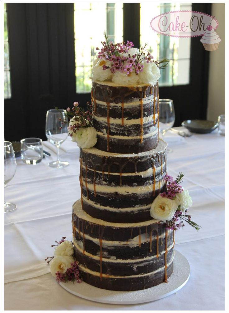 Naked Wedding Cake. Perfect for a rustic wedding theme. Decadent chocolate mud cake with caramel sauce and buttercream decorated with fresh flowers.