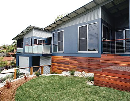 Warm timber tones, natural corrugated iron and deep grey-blues are the perfect scheme for a contemporary beach house. James Hardie website (exterior cladding products).