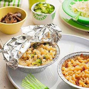 Mix-In Campfire Mac-and-Cheese (on the grill!): Whether you like it plain or fancy, mac-and-cheese just tastes better when you get to prepare it yourself and cook it to bubbly perfection.