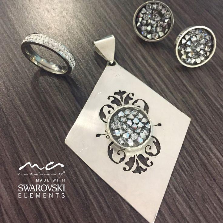 Aretes y dije en plata con cristales de Swarovski y anillo en acero