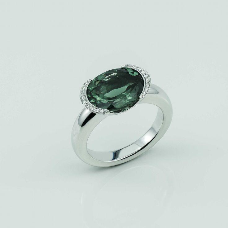 Green Tourmaline, diamond and white gold half bezel ring.