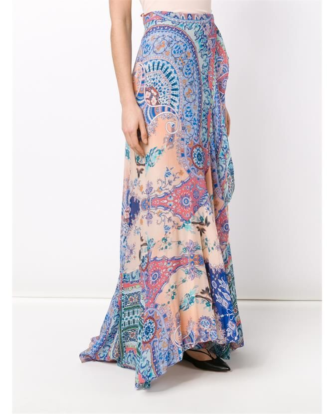 Multicolored printed silk maxi skirt showcases a stunning pastel toned paisley print. Fashioned in Italy, the fluid piece features a unique wrap-effect front with subtle ruffle detailing at the edges.