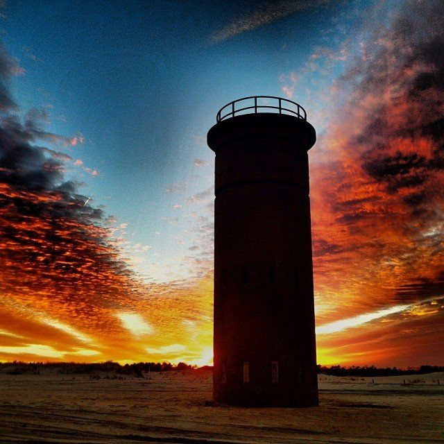 Sunset from Cape Henlopen State Park with a view of the WWII Observation Towers. Learn more at http://www.visitdelaware.com/listings/Cape-Henlopen-State-Park/1920/0.