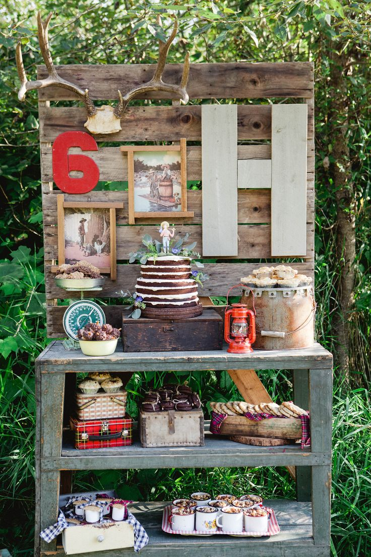 Adventure and Outdoors Themed Birthday Party Dessert Table - we love the wood pallet backdrop!