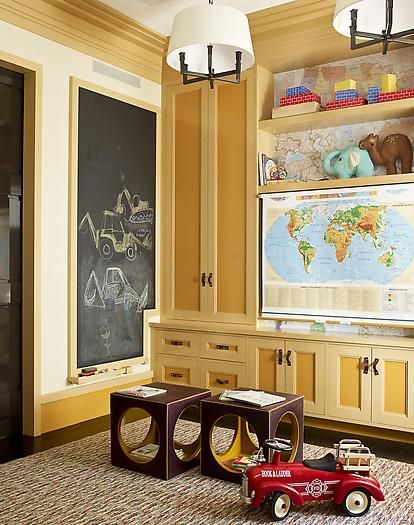 LOVE this!! especially the finish on the built in cabinets. Love the framing of the chalk board too!