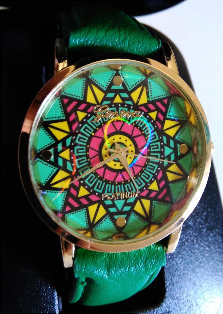 "Watch in ""Jamaican style"", available in green or pink. Fun decoration, and with the movement you will see a sparkling decoration on the dial."