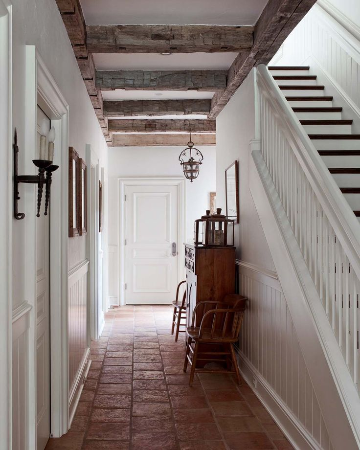 FARMHOUSE INTERIOR Vintage Early American Farmhouse Showcases Raised Panel Walls Barn Wood Floor And A Simple Style For Moulding Trim