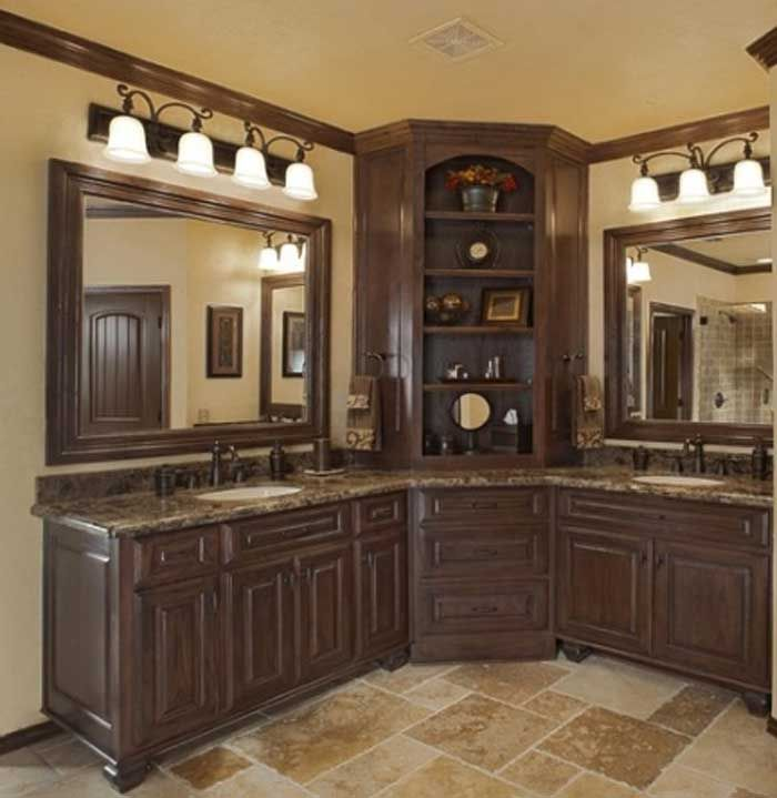 Corner bathroom sink vanity with some light and also double mirror and countertop granite