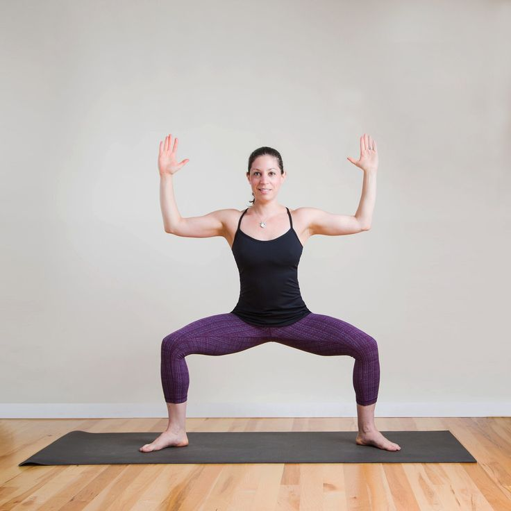 Stand at the front of your mat. Step open to the right, opening your legs about three feet apart. Turn your...