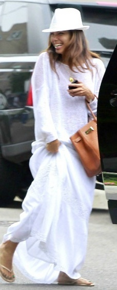 Who made  Eva Longoria's white maxi skirt, brown handbag and nude flip flops that she wore at LAX airport on August 24, 2012?