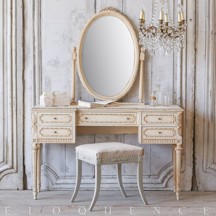 """Vintage Vanity: Circa 1930 Beautiful vintage Louis XVI style vanity in rosy cream finish with a lovely oval mirror. Classical square shape with five useful drawers for storage. Frame is adorned with delicate beaded carving around drawer fronts and a floral motif at crest of mirror. Wonderful piece for a boudoir. Desk height is 31""""."""