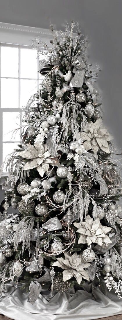 Gray and white decorations on your Christmas tree give it an elegant and icy feel. | Décor Aid |
