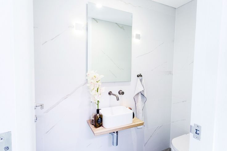 This elegant bathroom created on The Block Triple Threat features the Nu Marble Bianco and Concrete Fuse Lappato tiles from Beaumont Tiles. For more beautiful bathroom ideas visit http://www.beaumont-tiles.com.au/Room-Ideas/Bathrooms