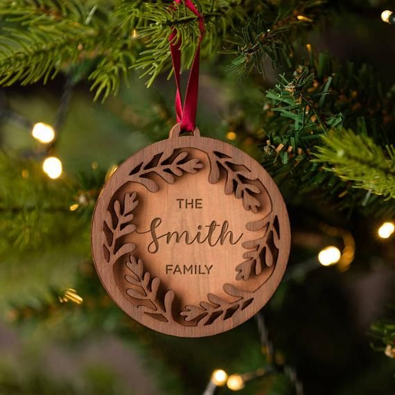 Personalised Christmas Bauble Family Name Ornament Personalized Xmas Tree Decorations Unique Engraved Wooden Bauble Wreath In 2020 Personalised Christmas Baubles Xmas Tree Decorations Christmas Baubles
