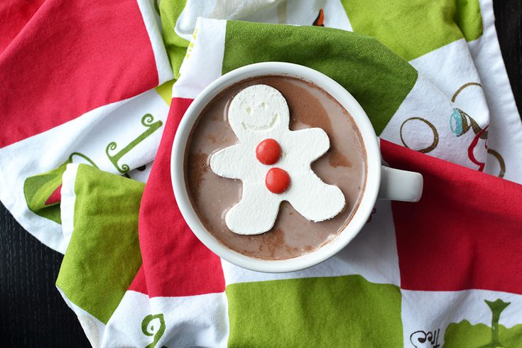 This Christmas, Give Cocoa a Cute Touch! One with a whipped cream gingerbread man smiling right back at you. Plus, those adorable red candy buttons make our hearts want to burst with happiness.