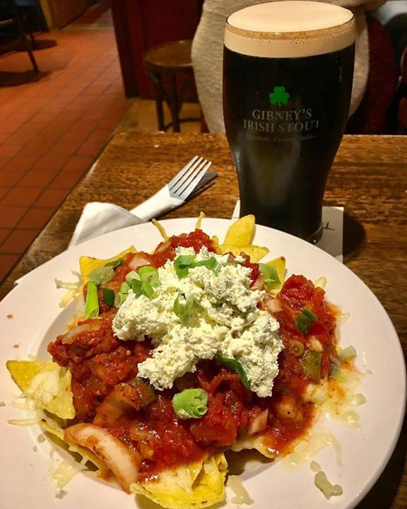 Nothing like a delicious plate of #nachos with #cheese and #salsa to accompany a delicious pint of #Gibney's #Stout. #Dublin #Malahide #Ireland #Eire #IgersDublin #Irish #Slante #food #foodporn #yummy #delicious #travel #tourism #tourist #leisure #life #CraftBeer #Instapint http://ift.tt/2epFDwa