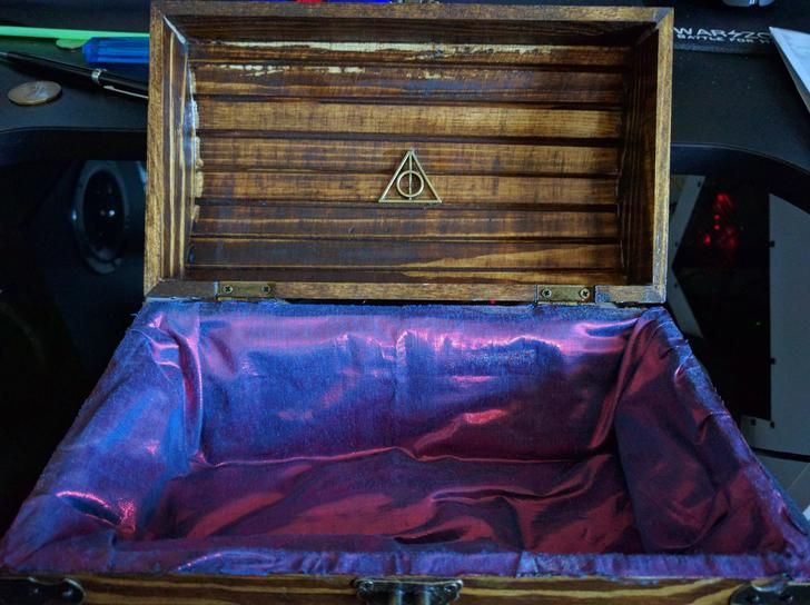 Hogwarts Chest (Girlfriends birthday present). I got this idea from a Redditor, and decided to put my own twist.