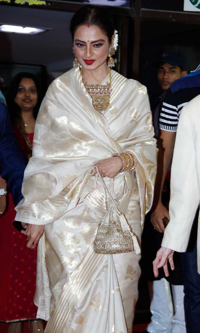 Rekha was in her signature silk sari - white and gold this time - with sindoor in her maang, red lips and gajra the 61st Idea Filmfare Awards South