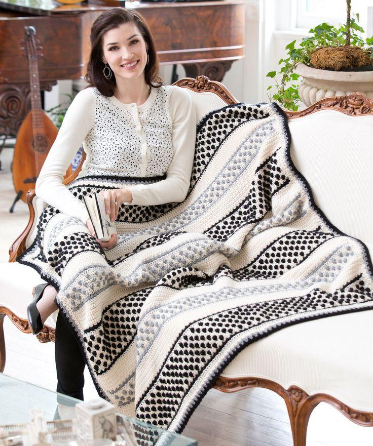 Diese Decke mit den schwarzen und grauen Noppen passt perfekt zu jedem Wohnstil. Du kannst die Farben auch passend zu deiner Wohnung ändern.