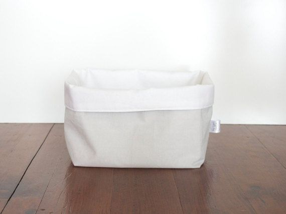 These are gorgeous, handmade fabric storage baskets, multipurpose throughout the home, or perfect as change table storage!  They are made from cotton outer and lining with interfacing between to give the baskets structure. They are fully reversible and can be folded down for a white cuff or left unfolded for extra height. Unfolded measurements are approx: Large square based basket: 23cm(L) x 21cm(W) x 19cm(H) Medium rectangular based basket: 25cm(L) x 11cm (W) x 16cm(H) **Not pictured**  I…